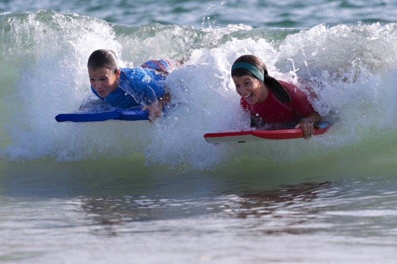 Kids in the surf New Quay Wales
