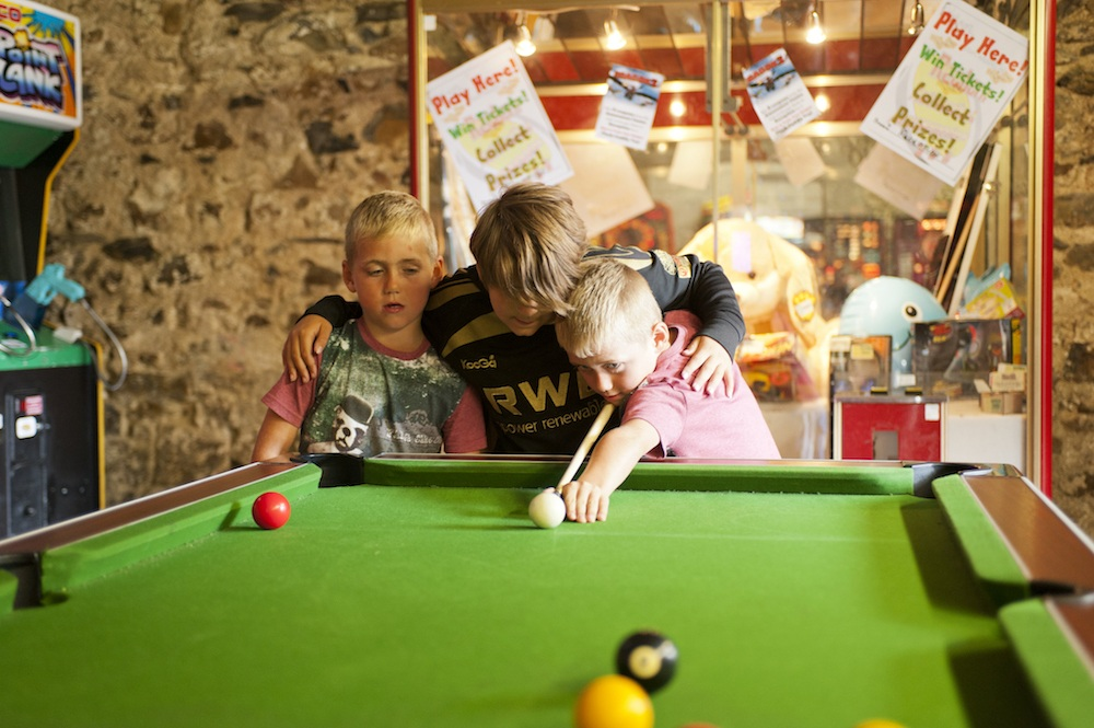 Playing pool at at Vale Holiday Parks